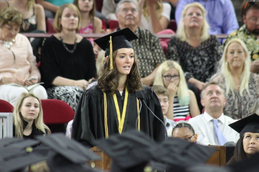 Brooklyn Schelhaas, an Arapahoe High School graduate, addresses her classmates. Schelhaas spoke at her dad's memorial service just nine days earlier, she told the crowd, but was determined to keep her chin up.