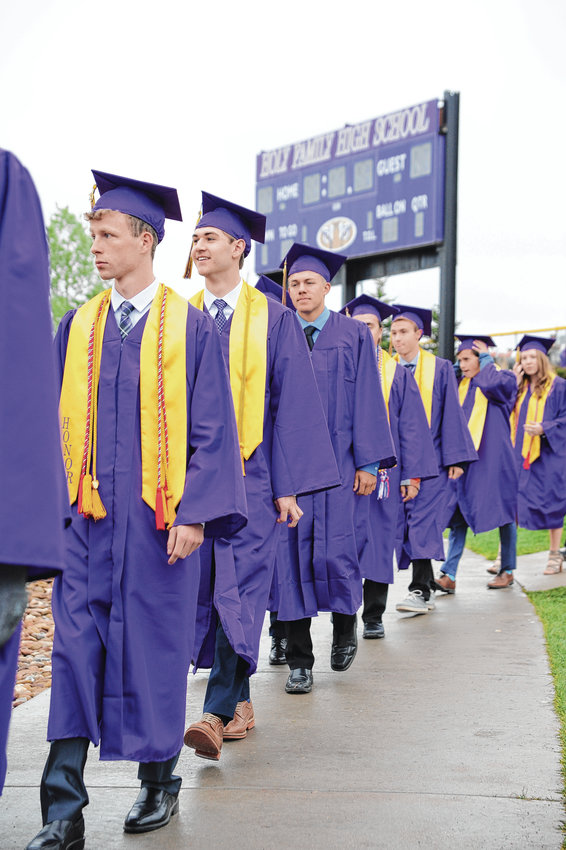 Graduates file into Mike Gabriel Stadium at Holy Family High School in Broomfield for 2019 commencement ceremonies May 23. 163 received diplomas.