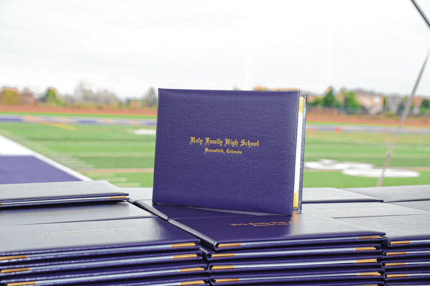 Diplomas await Holy Family High School graduates, prior to the start of formal commencement ceremonies in Broomfield May 23 at Mike Gabriel Stadium.