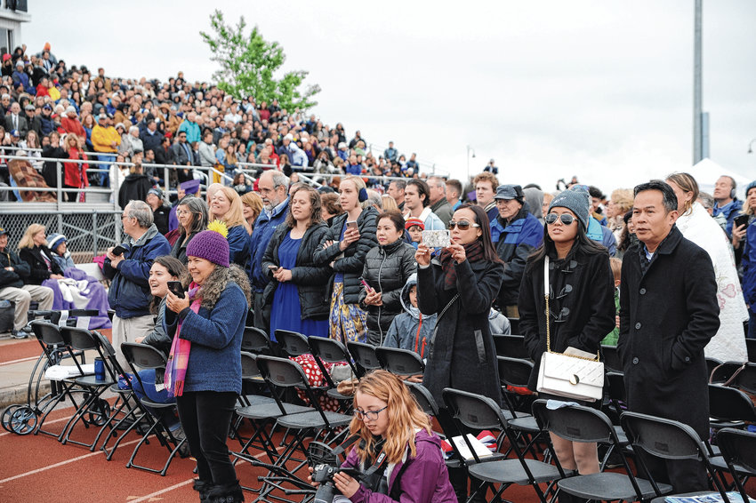 Families of 2019 Holy Family graduates try and catch a glimpse of their loved ones, at the start of the school's commencement ceremonies May 23, in Broomfield.