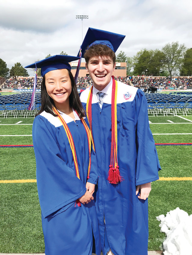 Mable Miao, senior class president, and Emmett Miller, student body president, stand together before the start of the 64th annual commencement for Cherry Creek High.