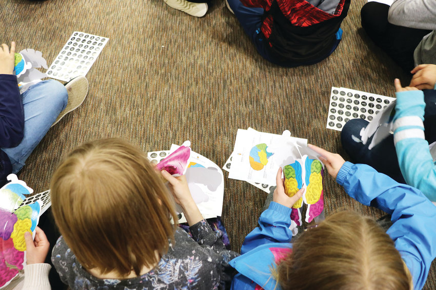 "Trailblazer Elementary School students make ""brain hats"" to better understand memory loss diseases. Dr. Thomas Lally, founder of Bloom Healthcare in Wheat Ridge, led the May 7 activity."