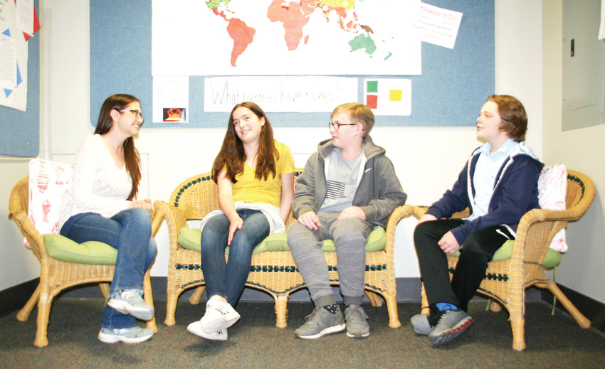 Erin Bertelsen, far left, a PhD student at the Colorado School of Mines, talks with Evangelene Jones, Matteo Bashford and Griffin Leapley — three of the 27 students who just completed the seventh-grade honors social studies class at Drake Middle School. Bertelsen and Kevin Pastoor, both working toward a PhD in radiochemistry from Mines, taught one class period about the science and makeup of the atom bomb for the seventh-graders' class project.