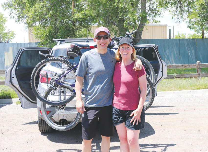 Arvada residents Mark and Christy Nelson relax after enjoying a bike ride in Gold Strike Park.