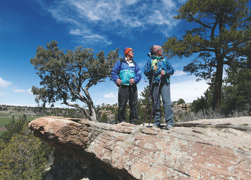 Two parkgoers stand atop a rocky area at Castlewood Canyon State Park near Castle Rock.