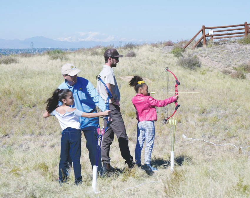 Kids engage in archery at Rocky Mountain Arsenal National Wildlife Refuge.
