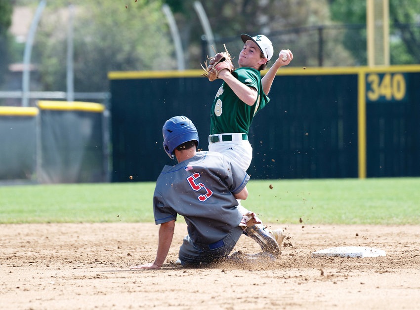 Mountain Vista's Aidan Smith (8) makes the attempt back to 1B before the collision with Cherry Creek's Clay Cutter (5). Cherry Creek ended up on top 4-1 before losing the State Final to Regis Jesuit 8-3 at All City Field on Saturday.