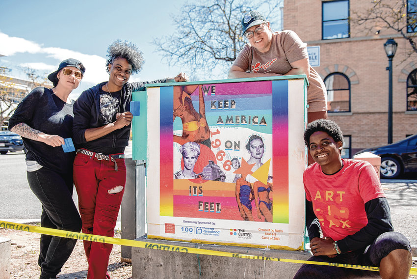 From left, Danie Vigil, Adrienne Norris, Allison Torvik and Vensha McGee pose for a picture after installing a vinyl sticker collage designed by a student from East High School on an electrical box on the corner of East Colfax Avenue and North Lafayette Street on May 11. A group of adult volunteers helped students from the East High School National Arts Honor Society install art in recognition of the 50th anniversary of the Stonewall riots in New York CIty, which launched the modern-era fight for LGBTQ rights.