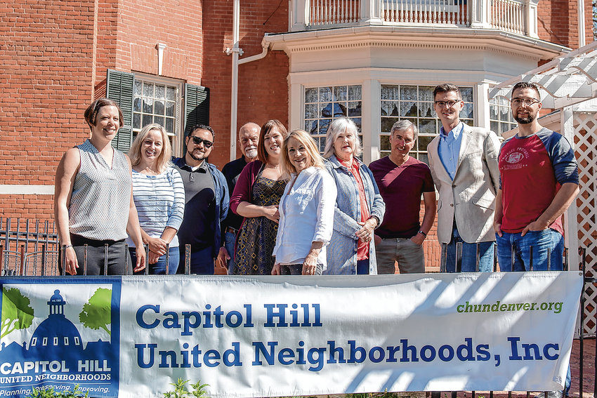 Capitol Hill United Neighborhoods (CHUN) executive committee members pose in front of the Tear-McFarlane House on Williams Street in Denver on May 11. CHUN is celebrating its 50th anniversary of planning, preserving and improving Denver's Capitol Hill community.