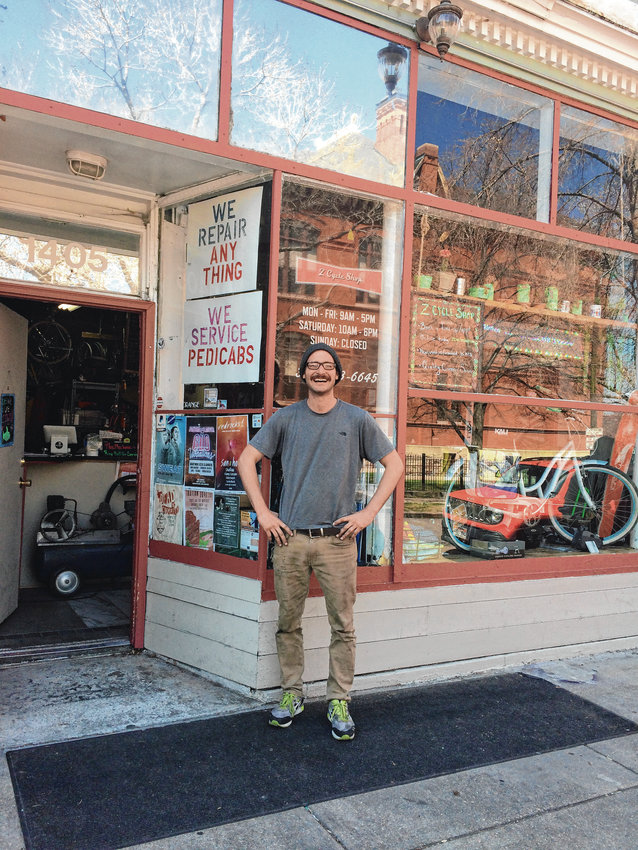 Dmitri Rumschlag stands in front of Z Cycle Shop in Capitol Hill. Rumschlag opened the shop last year and works to build relationships with his customers. He also hopes to make biking more accessible to everyone.