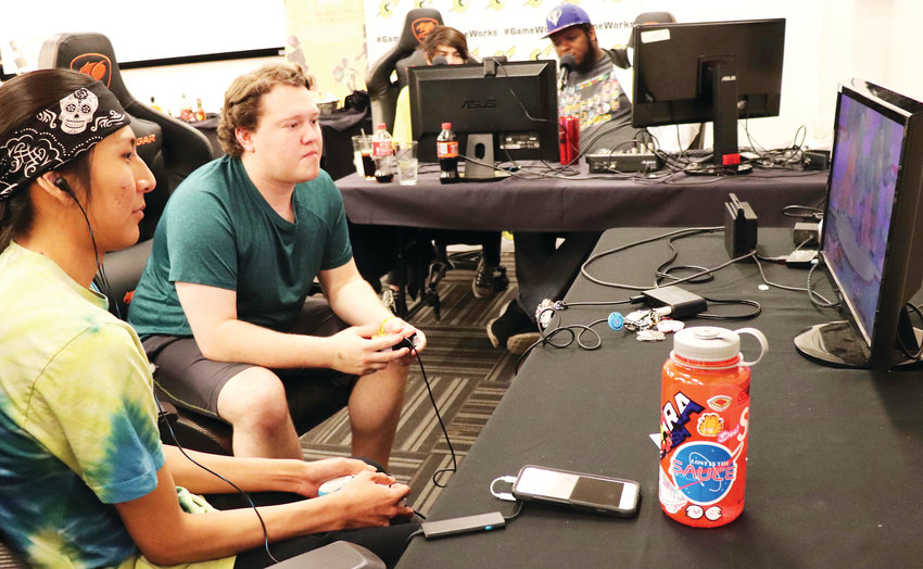 Lennon Gashwazra, left, and Josh Shoeman compete in the final local round of national Super Smash Bros. tournament GameWorks Showdown.