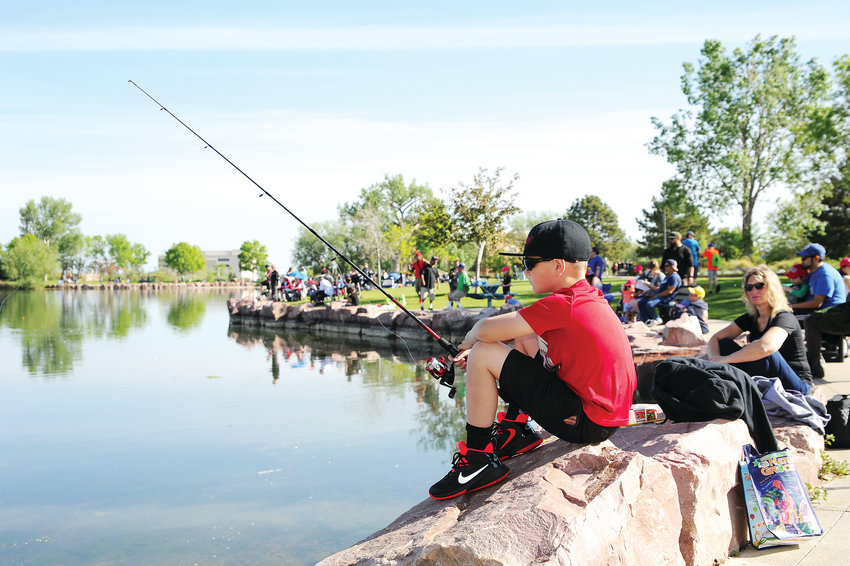Billy Sabetta, 10, of Thornton, left, awaits a strike on his line, as his mother Kelly, looks on, during Northglenn's Annual Fishing Derby June 1, at E. B. Rains, Jr. Park.