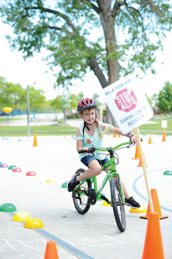 Kaylee Jewart, 8, of Commerce City, brings her bike to a stop, as part of a Bicycle Colorado obstacle course, during the Bike Rodeo portion of Northglenn's Derby Day June 1.