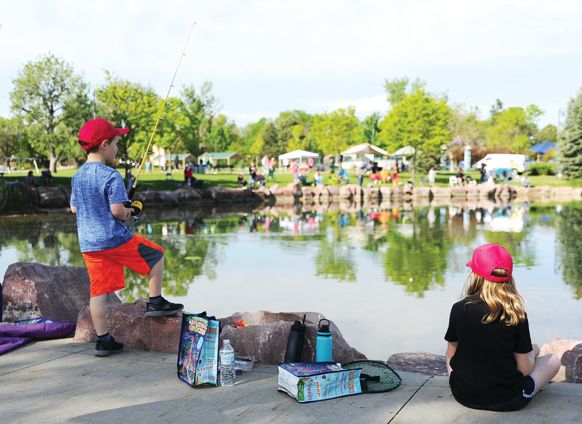 Calvin Hahn, 6, left, and his sister Audrey, 9, of Westminster, patiently await any activity on their fishing lines June 1 at Northglenn Fishing Derby, at E. B. Rains, Jr. Park. The annual event drew nearly 250 participants.