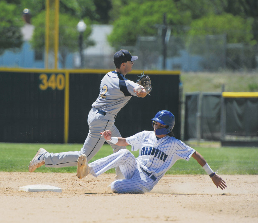 Legacy junior second baseman Tyler Lyons, top, tries to complete a double play against Grandview in a CHSAA State 5A Playoff game May 24, at Denver's All City Field. The Wolves beat the Lightning, 4-1.