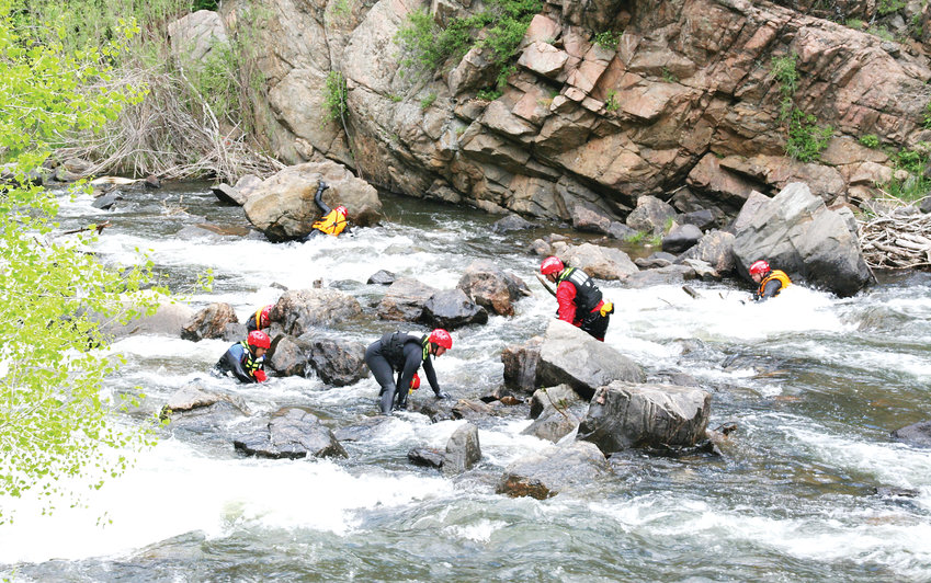 Area firefighters perform a mock search in Clear Creek Canyon near Tunnel 1 on U.S. 6, which is just west of Golden, during a training exercise on May 31. Fifteen firefighters earned their swift water rescue technician certification that day. Participating fire departments were West Metro Fire Rescue, South Metro Fire Rescue, Arvada Fire Department and Westminster Fire Department.