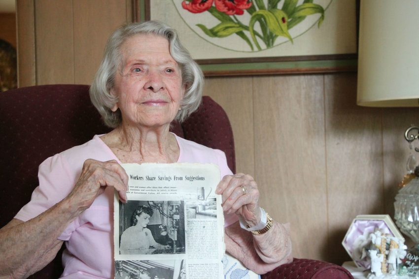 "Ruth Mullis, 96, holds a picture of herself working in an aircraft plant in the 1940s. Mullis, of Littleton, is one of Colorado's few remaining ""Rosies"" — women who took on men's roles in labor and business during World War II. Unable to attend a national reunion this year, Mullis is hoping to meet other Rosies in the area."