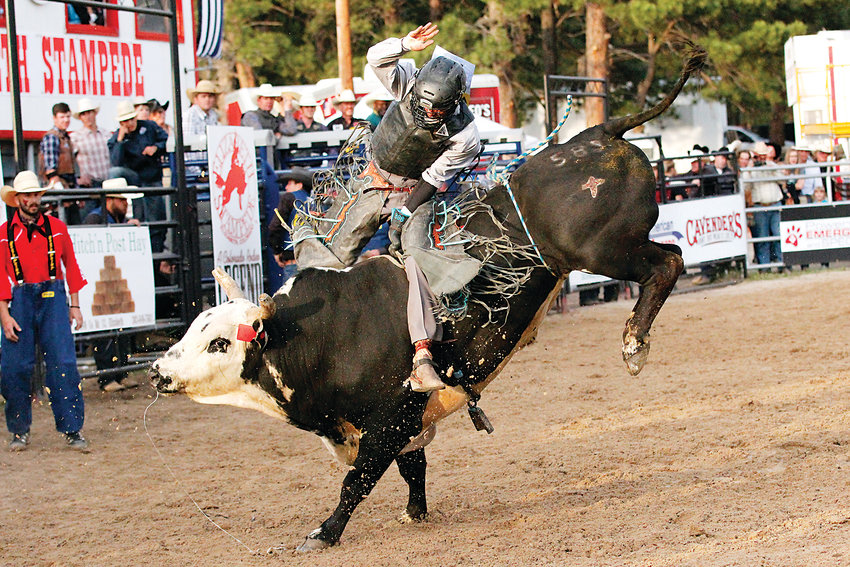 Hawaii native Aukai Kaai holds on as his bull, Bell Ringer, bucks and bounces before throwing Kaai to the ground. Only five of the 43 cowboys at the Xtreme Bulls rodeo earned a score on June 7 as bull after bull proved too much for their riders.