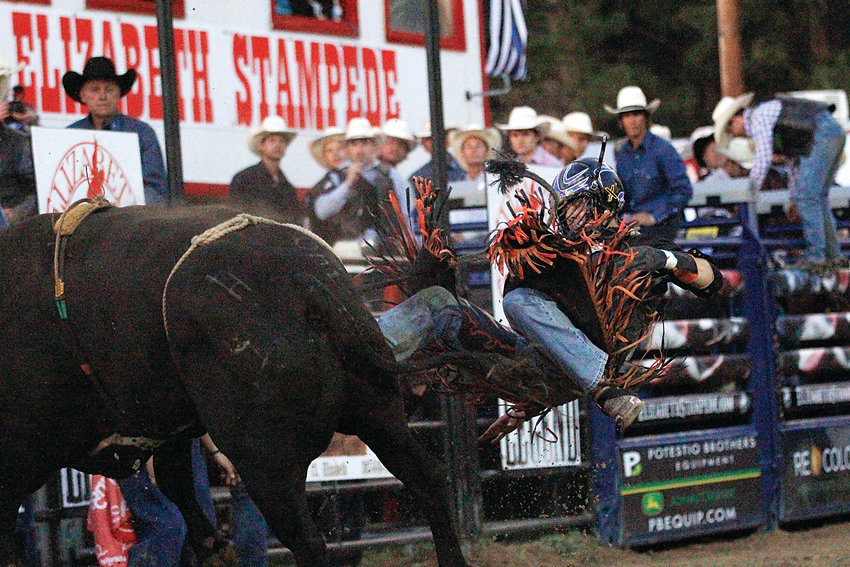 Charlie Hayes of Colorado Springs catches some air at the Elizabeth Stampede's Xtreme Bulls rodeo on June 7.