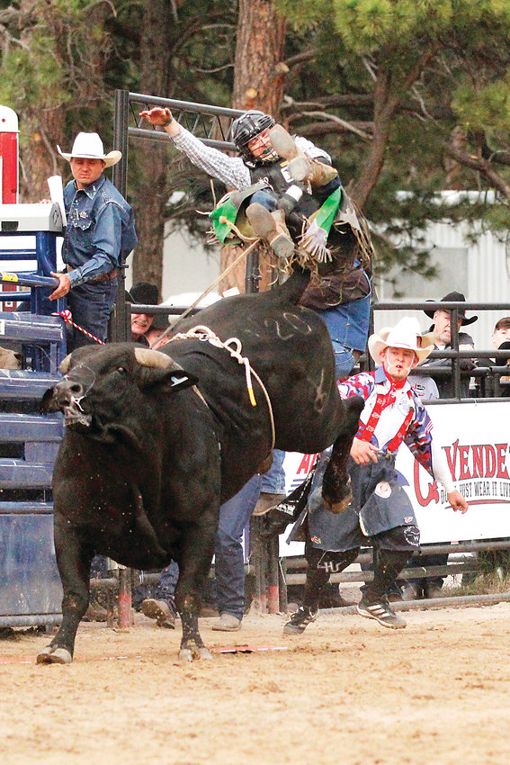 Clayton Enzminger of Steele, North Dakota, takes to the air after a short ride on his appropriately named bull, Rocky Road. Enzminger was the second of 43 riders during the Xtreme Bulls rodeo at the Elizabeth Stampede on June 7.
