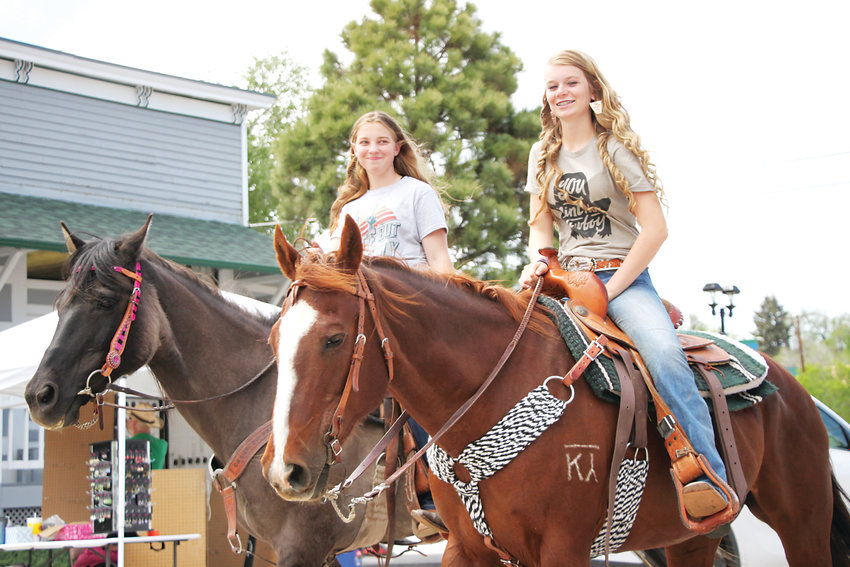 Laramie Taylor, left, rides her horse Dillon, while Braylon Briddle sits astride Millie. The pair rode in the Stampede Parade.