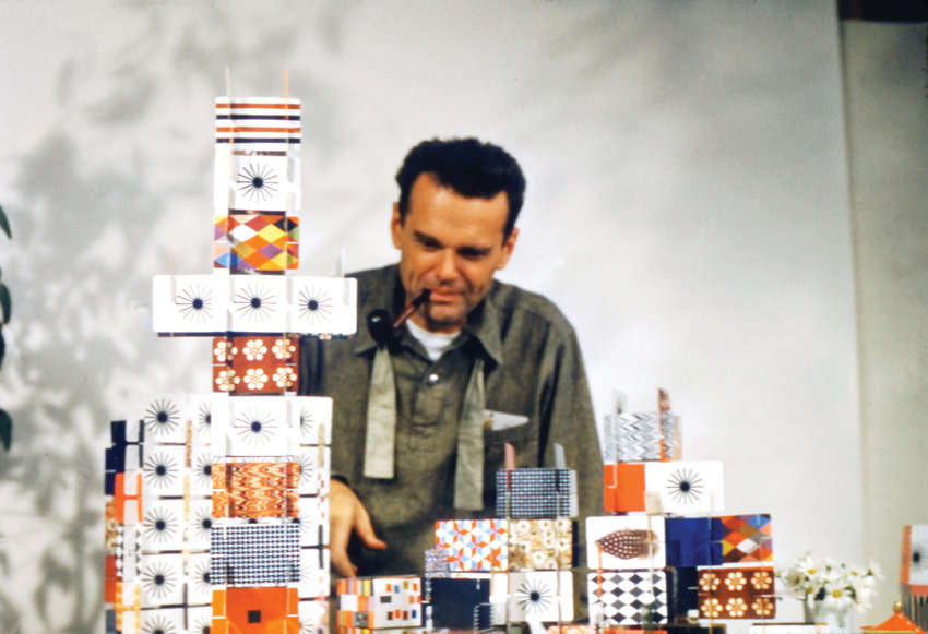 "Designer Charles Eames builds a giant House of Cards. Eames' works are included in ""Serious Play: Design in Midcentury America"" at the Denver Art Museum."