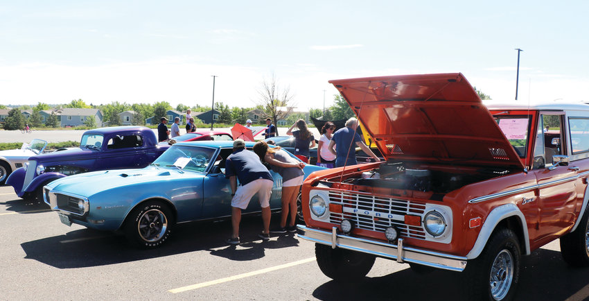 Car enthusiasts examine one-of-a-kind cars at the 19th annual Classic Car Show, hosted by the Highlands Ranch Community Association. The event took place June 8 at the parking lot of Cherry Hills Community Church.