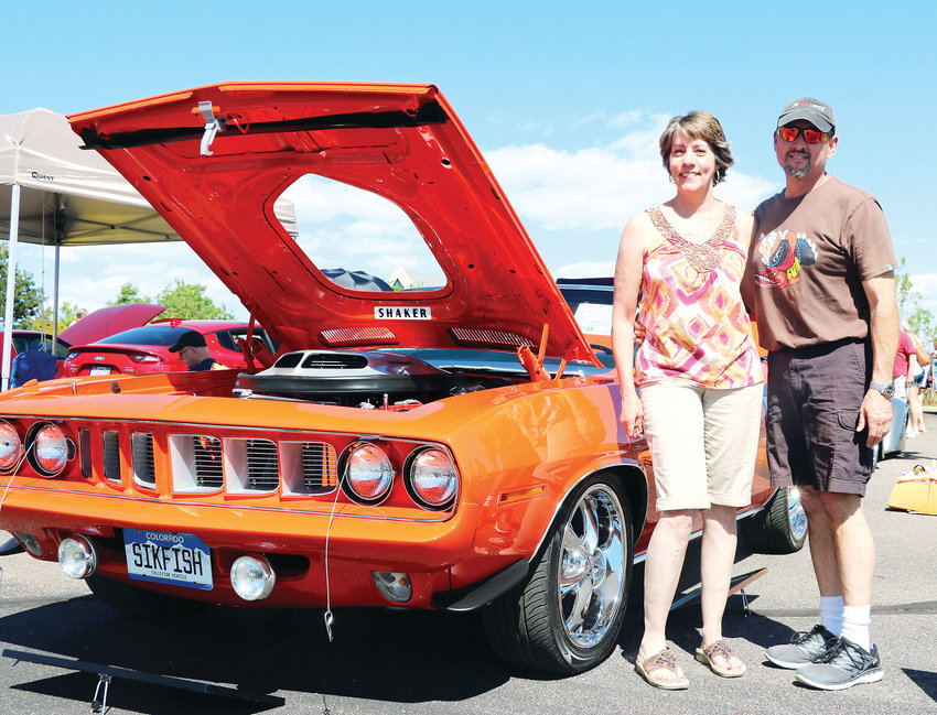 Linda and George Terpenning participate in the 19th annual Classic Car Show alongside their 1971 Plymouth Hemi Cuda. The June 8 event at Cherry Hills Community Church drew hundreds of community members and one-of-a-kind cars.
