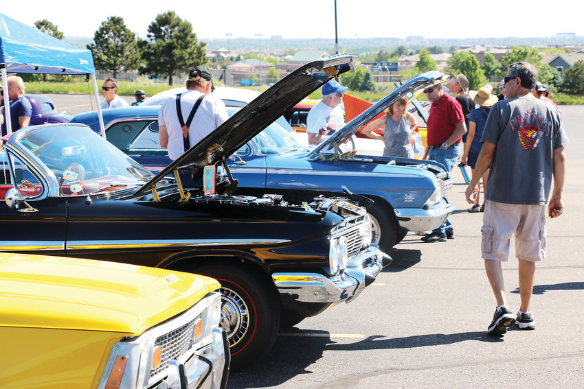Hundreds of people visit the parking lot at Cherry Hills Community Church on June 8 to view the inner-workings of many classic motor vehicles.  The Highlands Ranch Community Association hosts the annual event.