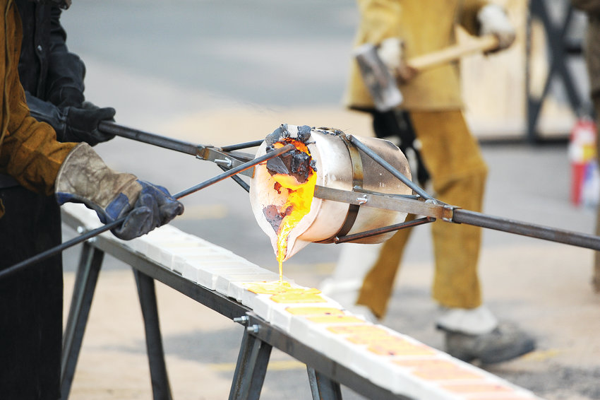 Molten iron is poured into molds designed by local residents, during Northglenn's Community Iron Pour on June 5 in the old police vehicle parking lot, adjacent to City Hall. The event was part of Northglenn's ongoing 50th anniversary celebration.