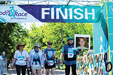"Team ""We Love Eggs,"" which was created by Erica Inerfeld and carried on by her friends and family, finishes the 2019 race. From left to right: Cathy Tate, Zora Dash, Charl Norloff, Barbara Inerfeld."