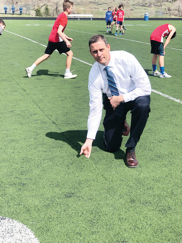 Legend High School Principal Jason Jacob shows the wear and tear of his school's turf field, used by hundreds of students in Parker. Funds from the bond passed by Douglas County voters last November paid for a replacement of the field.