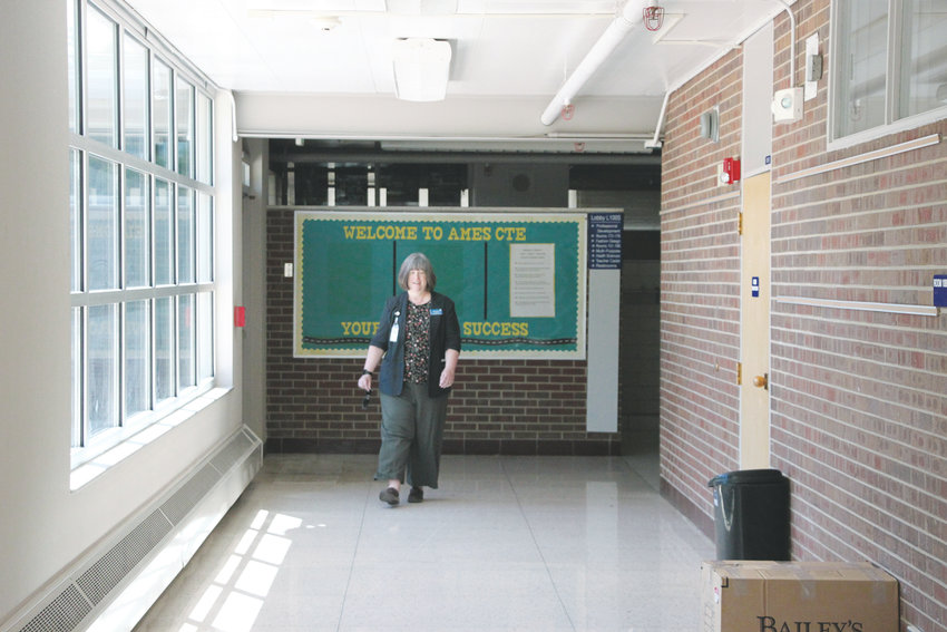 Littleton Public Schools Assistant Superintendent Diane Doney walks down a hallway in the old Ames Elementary School building, which is slated for demolition to make way for a replacement. The school closed in 2008 and has been home to a preschool and Meals on Wheels program since then.