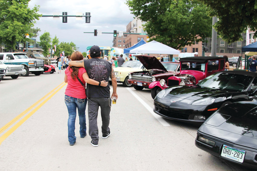 People strolled downtown streets as they looked at cars in the Castle Rock car show on June 15.
