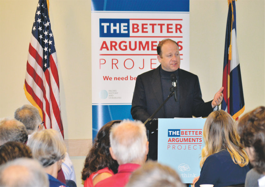 Colorado Gov. Jared Polis gives the opening address June 13 at Anythink Library's Wright Farms branch Better Arguments workshop that drew more than 100.
