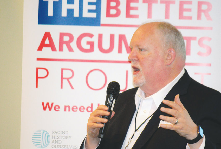 Roger Brooks, president of global educational organization Facing History and Ourselves, leads a group discussion on the impacts of Denver's tech boom June 13 at the at Anythink Library's Wright Farms Branch Better Arguments workshop.