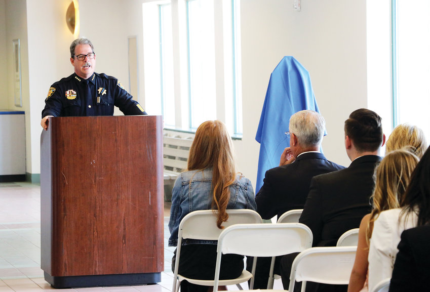 "Douglas County Sheriff Tony Spurlock talks about his fallen deputy, Zackari Parrish, at the Highlands Ranch Post Office. On June 17, dignataries renamed the building the ""Deputy Sheriff Zackari Spurlock Parrish, III, Post Office Building."""
