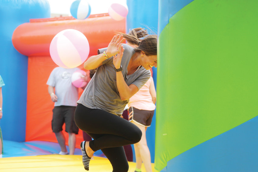 Games and activities were scattered around the floor of the bounce house. Bouncers pelted each other with inflatable beach balls in a game of dodge ball June 16 at the Meridian Park.