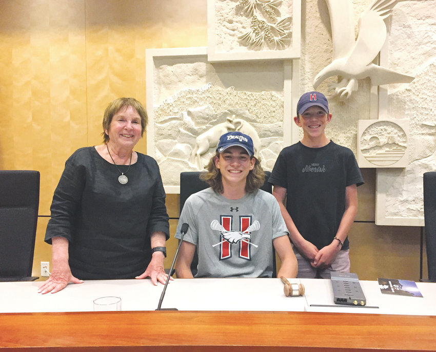 Golden Mayor Marjorie Sloan, left, gets her picture taken with the McCarthy brothers, Liam, 16, seated, and Keegan, 15, during a special meet-and-greet following the June 13 Golden City Council meeting. The two brothers are Boy Scouts from Troop 361 in Littleton and attended the city council meeting to earn a merit badge for communication and citizenship in community as part of pursuing their Eagle rank. The boys attended the entire meeting, which lasted about three-and-a-half hours. In that time, they learned about the Astor House, Golden Municipal Code changes, the possible purchase of the Coors building for a new civic center and more. Although they were unfamiliar with all of the topics prior to the meeting, the Boy Scouts said it was an interesting meeting and that they learned a lot about how city council meetings, in general, function.