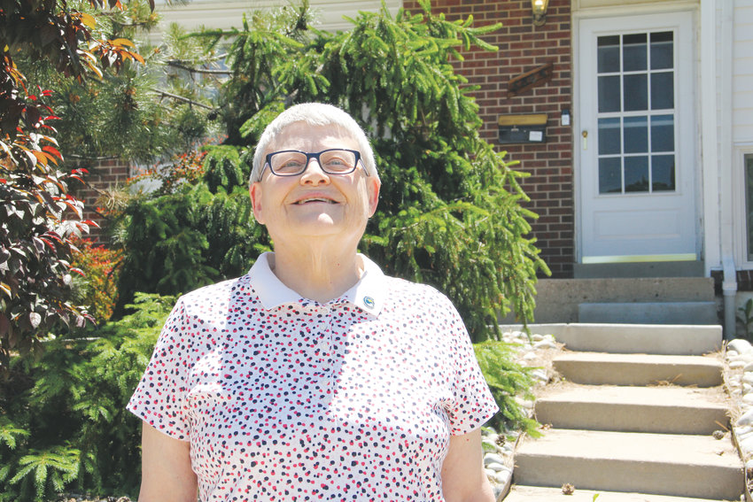 Andrea Suhaka, a longtime Centennial resident and former Centennial city councilmember, stands in front of her home June 13 in west Centennial, not far from East Arapahoe Road and South Quebec Street.