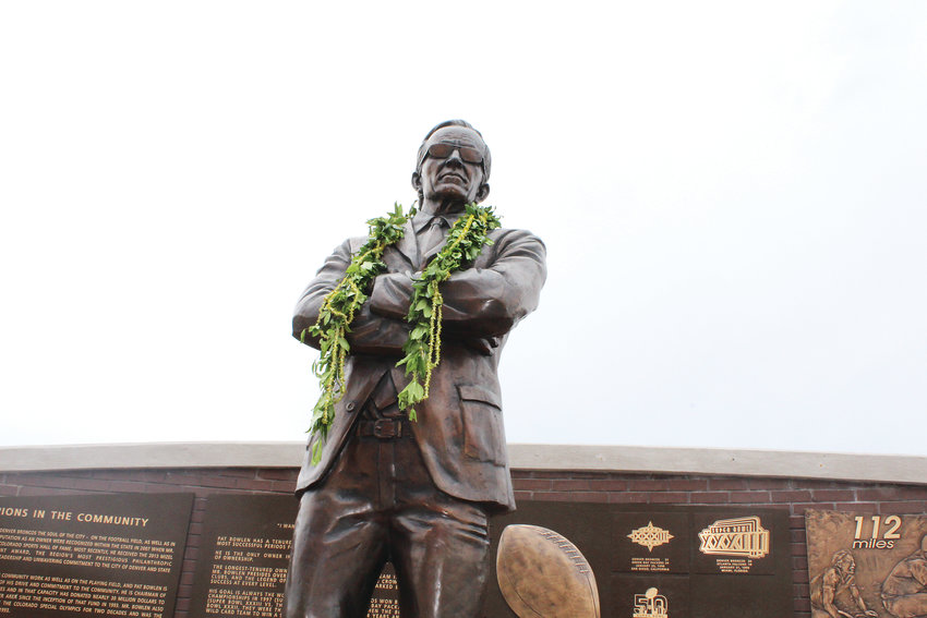 Pat Bowlen's statue, which rests outside of Broncos Stadium at Mile High. Residents laid flowers below his statue after his death.