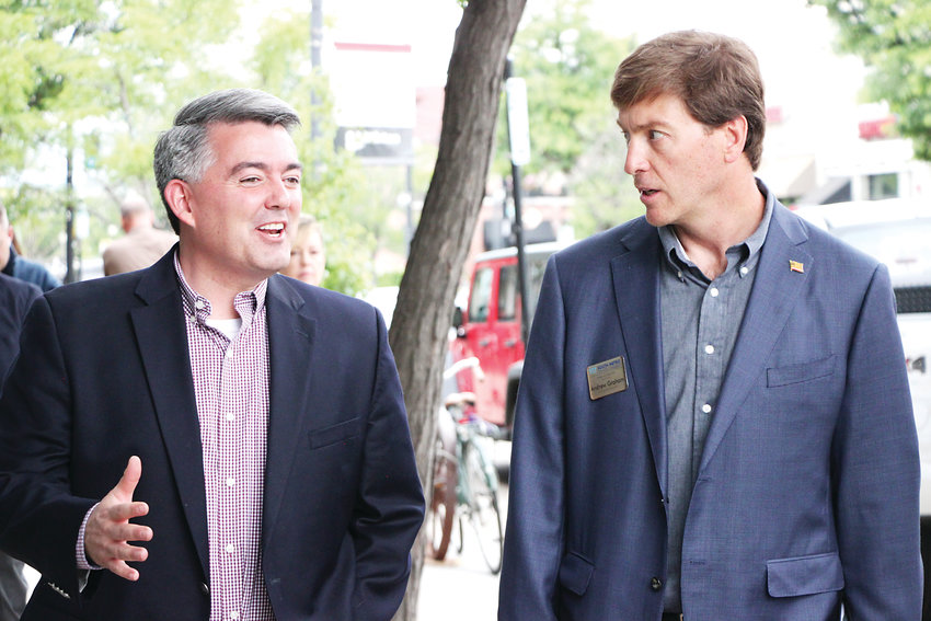 Senator Cory Gardner, left, chats with South Metro Denver Chamber of Commerce Chairman Andrew Graham on Main Street in Littleton on June 17.