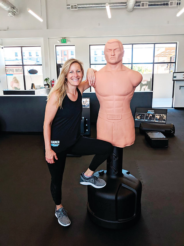 Maggie Lindberg runs a fitness center in Castle Rock for women.