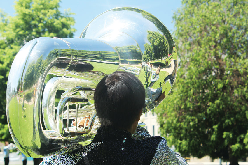 A tuba player with the Blue Knights plays during a performance in Denver. Typically, the Blue Knights perform in formations, but the June show was a standing performance at the Greek Amphitheatre in Civic Center.