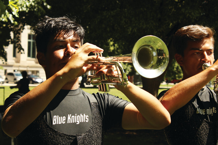 Jesus Alaya, left, and Greg Valean warm up for the Blue Knights performance on June 20.