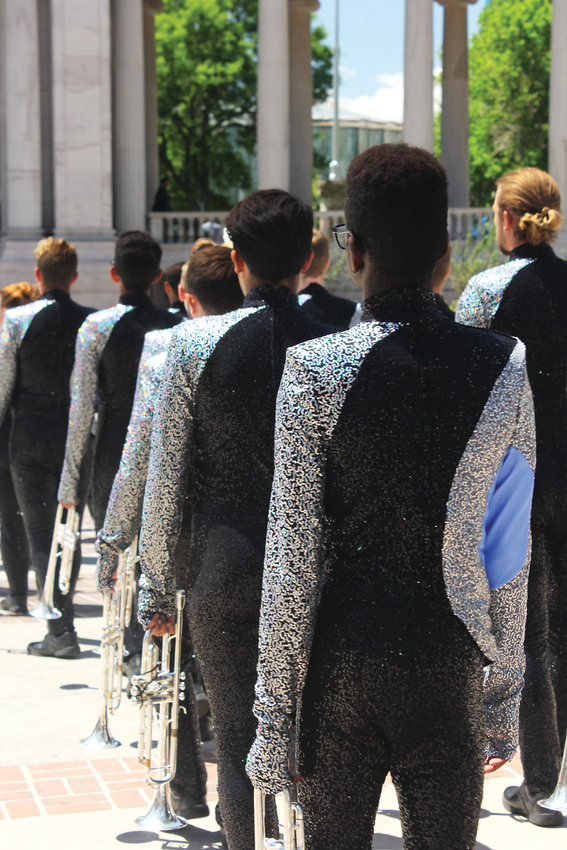 Horn players with the Blue Knights file into the Greek Amphitheatre before a performance at Civic Center in Denver.