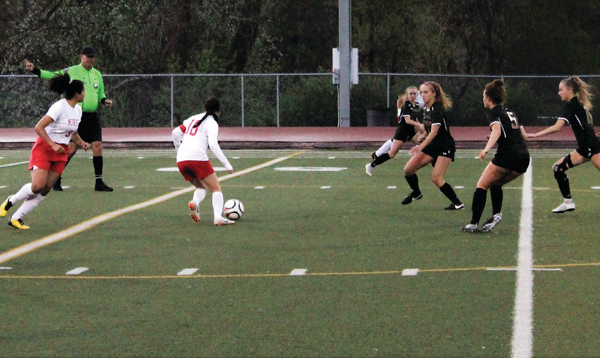 May 7 against Arapahoe, junior captain Samantha Dominguez Reyes pushes the ball in first round of the 5A state playoffs.