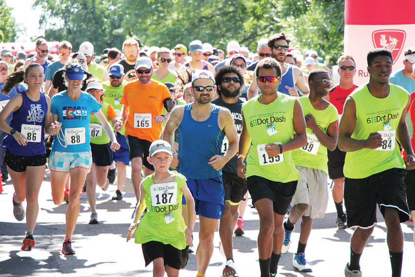 Runners, many of whom are blind, take off down the track at the 6 Dot Dash 5K race near Littleton's Sterne Park on June 29. The race, hosted by the National Federation of the Blind of Colorado, supports braille literacy programs.