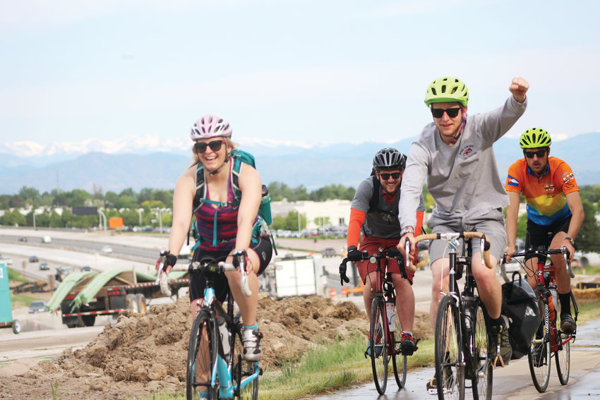 Three people trek uphill toward the Yosemite and C-470 interchange along the Willow Creek Trail June 26 for Bike to Work Day 2019.