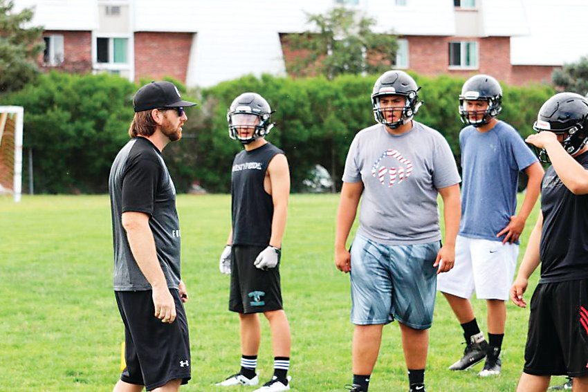 Westminster High School football coach Dayne Allbrandt talks to his team during summer workouts.